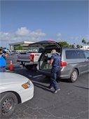 sandbags getting put in someones open trunk