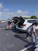 staff grabbing sandbags